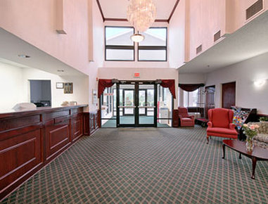 Super 8 Motel Naperville Aurora - A beautiful specious lobby with an exclusive chandelier   The lobby is alive with fresh flowers and plants   All woodwork is finished in cherry   All this is topped by friendly and helpful staff