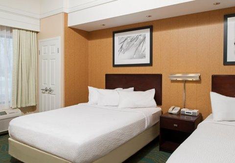 Springhill Suites Grand Rapids Airport Southeast Hotel - Queen Queen Suite - Sleeping Area