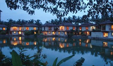 Vedic Village Spa Resort - Exterior At Night