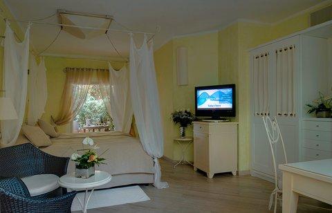 Fortevillage Royal Pineta - Guestroom Interiors