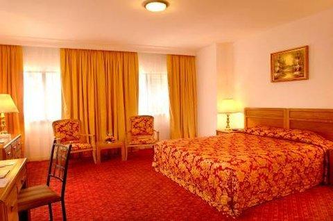 Golden Tulip Dalma Suites Hotel - Room