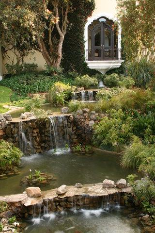 Hotel Vista Real Guatemala - Garden With Waterfall