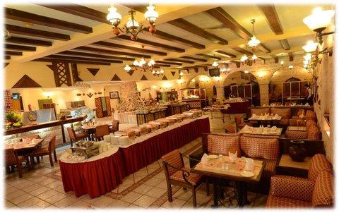 فندق و شقق مكة جراند كورال - Restaurant