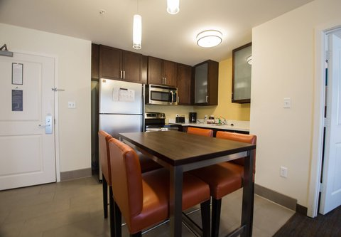 Residence Inn Omaha West - Two-Bedroom Suite   Kitchen   Dining Area