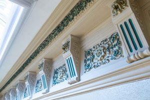Ornate cornices add a charm & elegance to the building