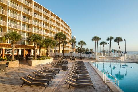 Holiday Inn Resort DAYTONA BEACH OCEANFRONT - Relax on our pool deck overlooking the Atlantic Ocean
