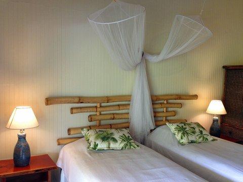 Sea U Guest House - Top Floor Room - local bamboo bed head