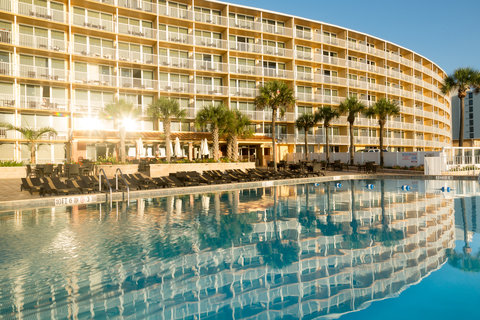 Holiday Inn Resort DAYTONA BEACH OCEANFRONT - Sunrise reflection over the resort pool and sun deck