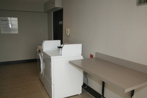 Holiday Inn Express & Suites SAN ANTONIO EAST - I10 - 4th Floor front loading laundry machine
