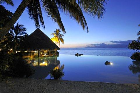 Intercontinental Resort Tahiti - Lotus Swimming Pool at night