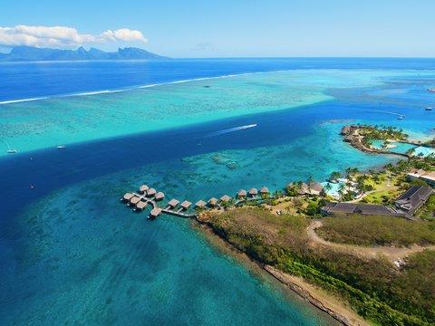 Intercontinental Resort Tahiti - Aerial View on Resort grounds  the lagoon and Moorea