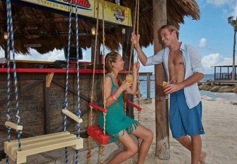 Curacao Marriott Beach Resort & Emerald Casino - Boardroom Beach Bar Swings