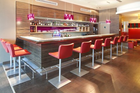 Holiday Inn ALMATY - Tipsy Bar serving specialty coffees  tea  snacks as we a full bar