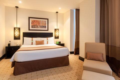 فندق هوليدي ان البرشا - Stay relaxed in our guest room