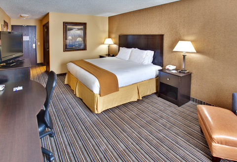Holiday Inn Express Hotel & Suites Council Bluffs Conv Ctr Area - King Bed Guest Room w  Chair   Ottoman   Refrigerator