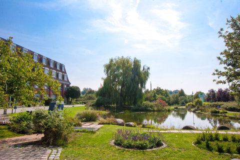 Holiday Inn LEIPZIG - GÜNTHERSDORF - view into the hotel garden