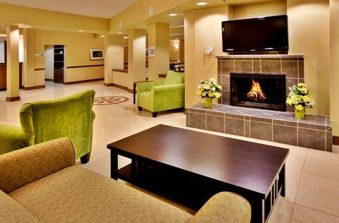 Holiday Inn Express WATERLOO-CEDAR FALLS - Stay warm by the cozy  fireplace