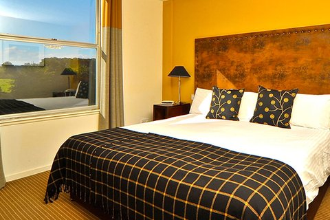 Eight Acres Hotel - Eight Acres Hotel Bedroom