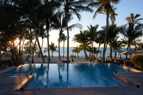 Tiamo Resort - beach view from infinity pool