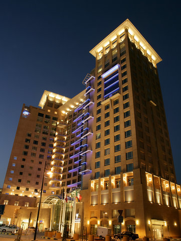 Al Manshar Rotana Hotel - Exterior Night Time