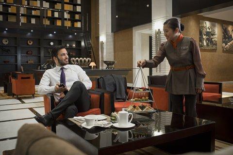 Al Manshar Rotana Hotel - Library Lounge