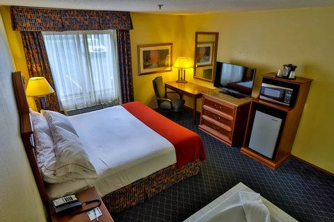 Holiday Inn Express BEMIDJI - King Bed Room features a 40  Flat Screen Smart TV and Whirlpool