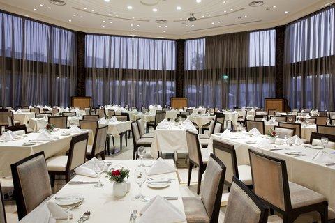 فندق هوليدي ان ازدهار - Restaurant Photo