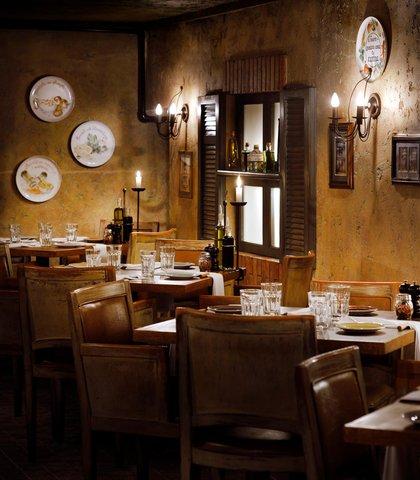 فندق ماريوت جي دبليو دبي - Cucina Restaurant Dining Area