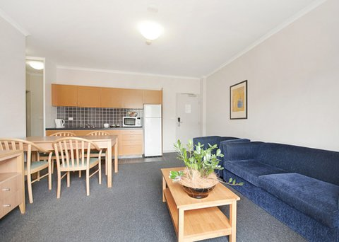 Quality Hotel Woden - QHWBedroom Apartment Lounge And Kitchenette Pic