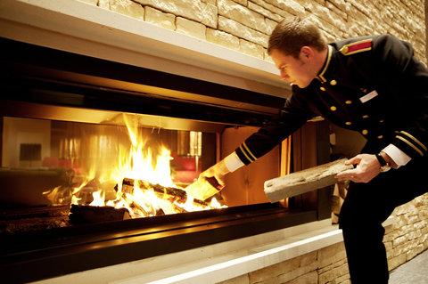 Kempinski Hotel Das Tirol - Lobby Fireplace - Concierge
