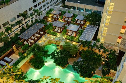 Anantara Baan Rajprasong Serviced Suites - Swimming Pool And Deck At Night