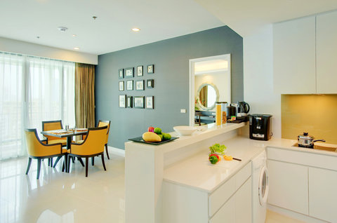 Anantara Baan Rajprasong Serviced Suites - Two Bedroom Suite Dining Area And Kitchen