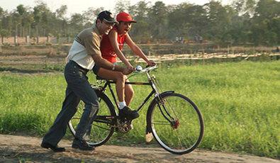 Vedic Village Spa Resort - Cycling through lush farmlands