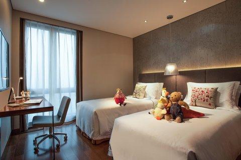 Modena Zhuankou Wuhan - Twin Bedroom