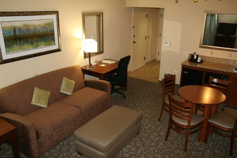 Hampton Inn Gainesville FL - King Suite Bedroom with Pull Out Sofa