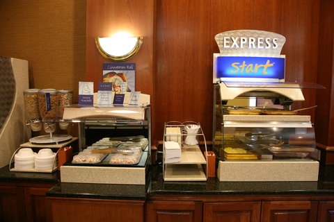 Holiday Inn Express & Suites DETROIT DOWNTOWN - Our Signature Cinnamon Rolls and Delicious Hot Breakfast Selection