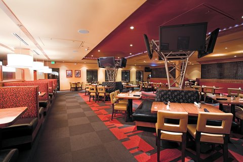 Holiday Inn Hotel & Suites DENVER AIRPORT - Sporting News Grill-Dining Area--Lots of Flat Screens