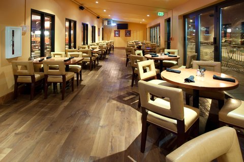 Holiday Inn Hotel & Suites DENVER AIRPORT - Sporting News Grill-Enclosed Patio Area