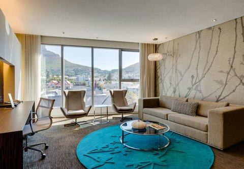 African Pride 15 on Orange Hotel - Deluxe Mountain King - Living Room