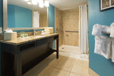 Holiday Inn Resort DAYTONA BEACH OCEANFRONT - 2 Queens Ocean Front Suite Bathroom Vanity and Walk-In Shower