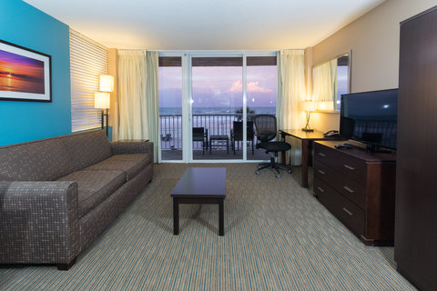 Holiday Inn Resort DAYTONA BEACH OCEANFRONT - Spacious living area in our suites featuring pull out sofa beds