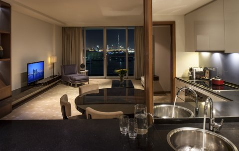 InterContinental RESIDENCE SUITES DUBAI F.C. - Three Bedroom Suite Living Room and Kitchen