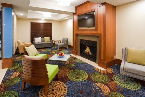 Holiday Inn Express CEDAR RAPIDS (COLLINS RD) - Hotel Lobby with comfortable seating and fireplace