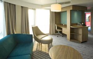 Deluxe room featuring extra sitting space and 42inch TV