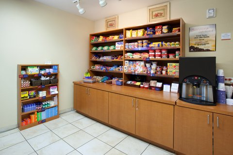 Candlewood Suites CHEYENNE - The Candlewood Cupboard features drinks  frozen meals   more