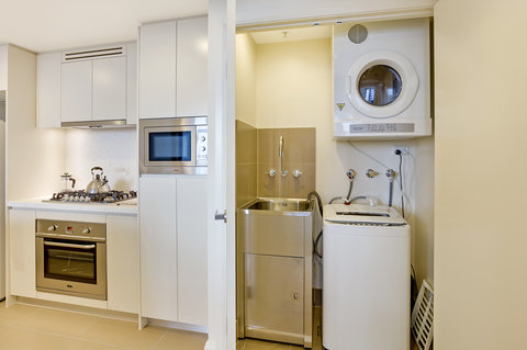Astra Apartments Rhodes - Rhodes Bedroom Serviced Apartment Laundry High Res