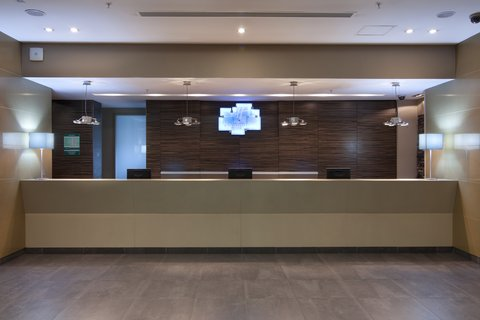 Holiday Inn ALMATY - Welcome front desk reception at Holiday Inn Almaty