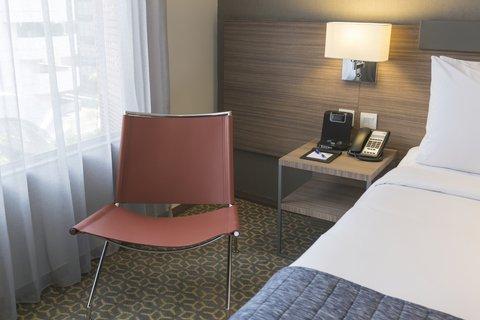 Holiday Inn Express Bangkok Sathorn - In Room Amenities - iPod Dock  Telephone  Universal Power Plug