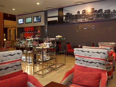 فندق هوليدي ان - Caf