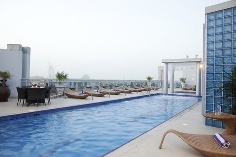 فندق هوليدي ان البرشا - Swimming pool perfect for laps at Holiday Inn Dubai - Al Barsha